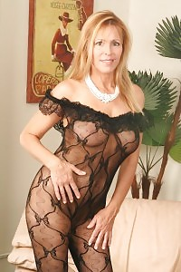 Beautiful Blonde Crystal In Elegant Casual Wear And Black Cloudy Hose.