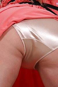Big Tittied Adilynn Poses On The Floor In Her Satin Gold Panties